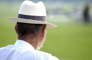 back of man's head in panama hat